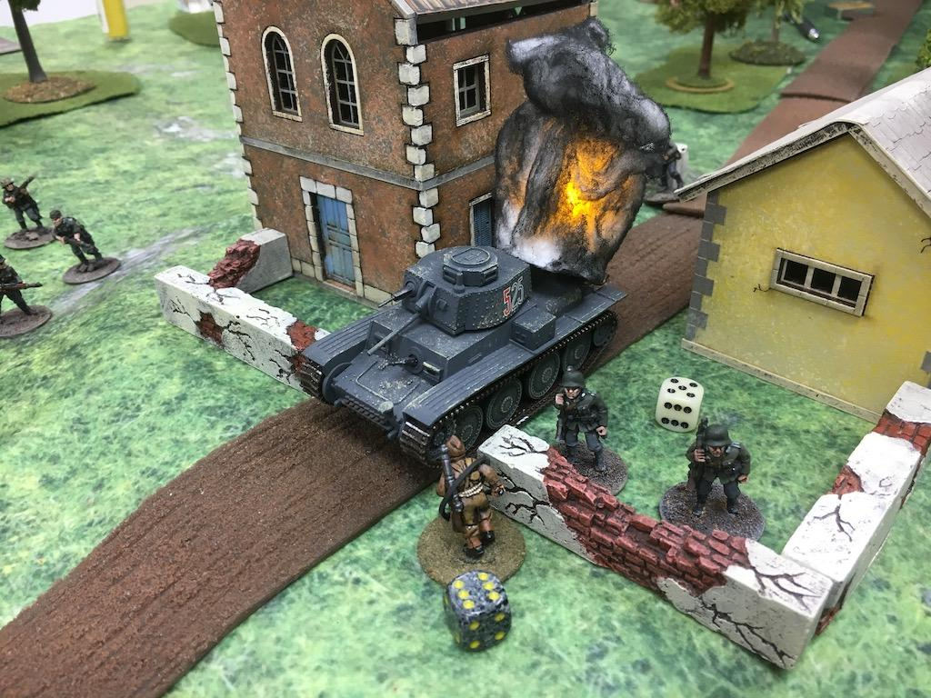 A commando destroys a 38(t) with a satchel charge