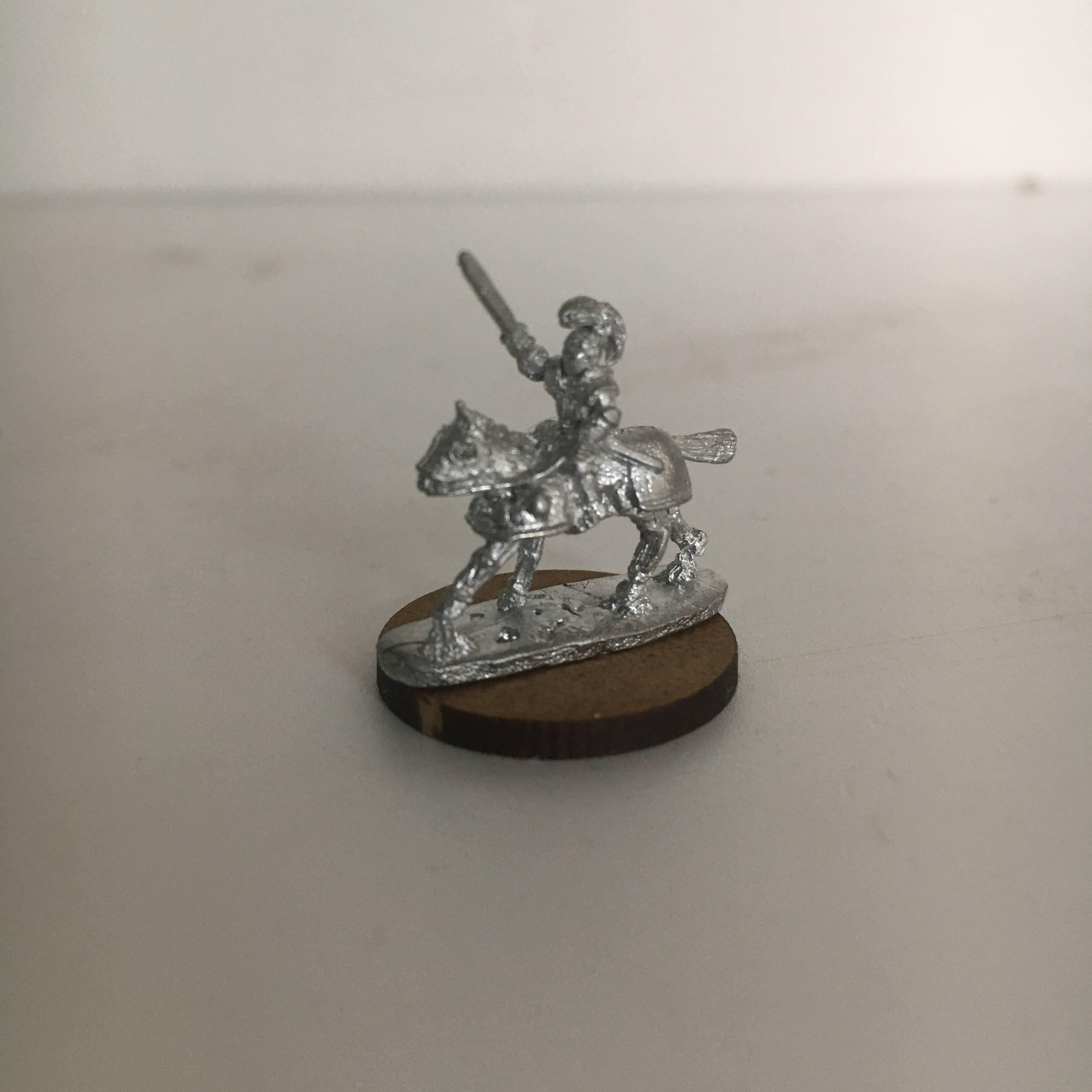 miniature knight on horse
